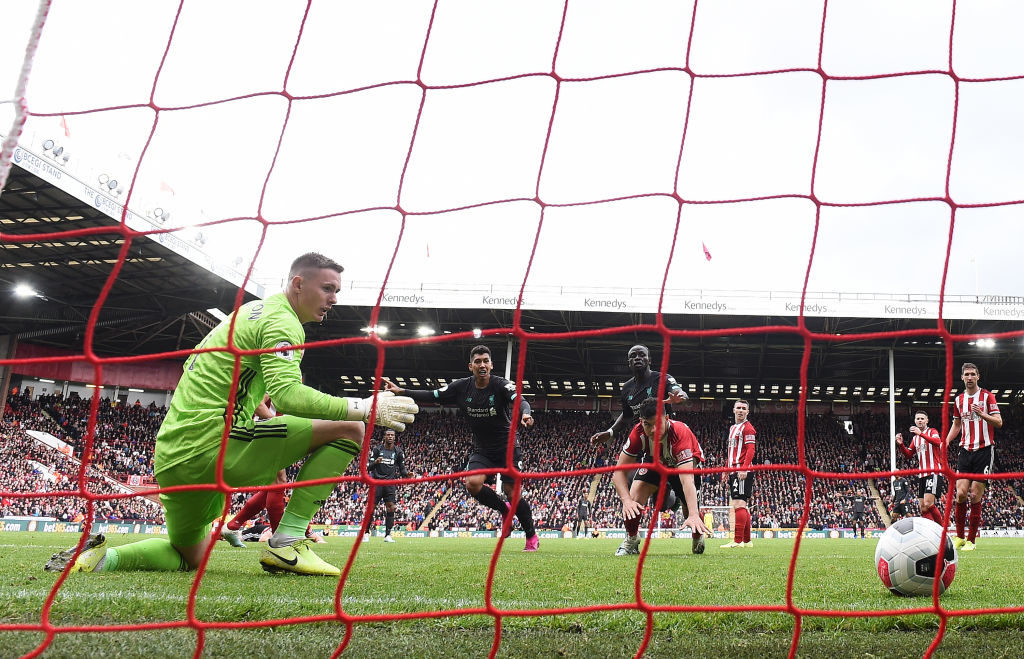 SHEFFIELD, ENGLAND - SEPTEMBER 28:   Dean Henderson of Sheffield United fails to saves Georginio Wijnaldum of Liverpool (obscure) shot which leads to Liverpools first goal  during the Premier League match between Sheffield United and Liverpool FC at Bramall Lane on September 28, 2019 in Sheffield, United Kingdom.