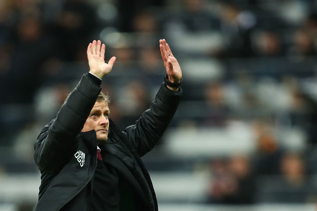 NEWCASTLE UPON TYNE, ENGLAND - OCTOBER 06: Ole Gunnar Solskjaer the head coach / manager of Manchester United waves to the fans at full time during the Premier League match between Newcastle United and Manchester United at St. James Park on October 6, 2019 in Newcastle upon Tyne, United Kingdom.