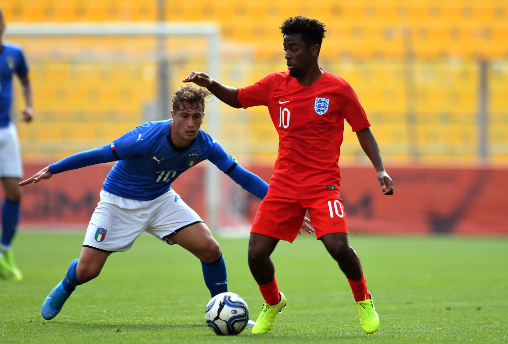 PARMA, ITALY - OCTOBER 10: Salvatore Esposito of Italy U20  competes for the ball with  Angel Gomes of England U20 during the 8 Nations Tournament match between Italy U20 and England U20 at Stadio Ennio Tardini on October 10, 2019 in Parma, Italy.