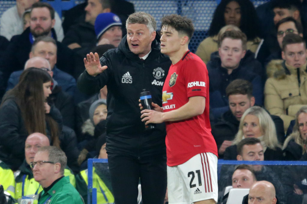 LONDON, ENGLAND - OCTOBER 30: Ole Gunnar Solskjaer with Daniel James of Manchester United during the Carabao Cup Round of 16 match between Chelsea FC and Manchester United at Stamford Bridge on October 30, 2019 in London, England. Brighton.