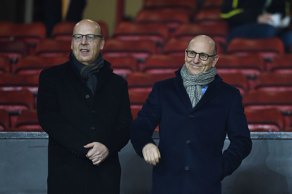 MANCHESTER, ENGLAND - FEBRUARY 11: Avram Glazer (L) and Joel Glazer, the Co-Chairmen of Manchester United look on during the Barclays Premier League match between Manchester United and Burnley at Old Trafford on February 11, 2015 in Manchester, England.