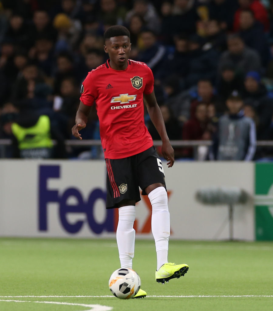 ASTANA, KAZAKHSTAN - NOVEMBER 28: Di'shon Bernard of Manchester United in action during the UEFA Europa League group L match between FK Astana and Manchester United at Astana Arena on November 28, 2019 in Astana, Kazakhstan. Teden Mengi debut against Norwich. United chance.