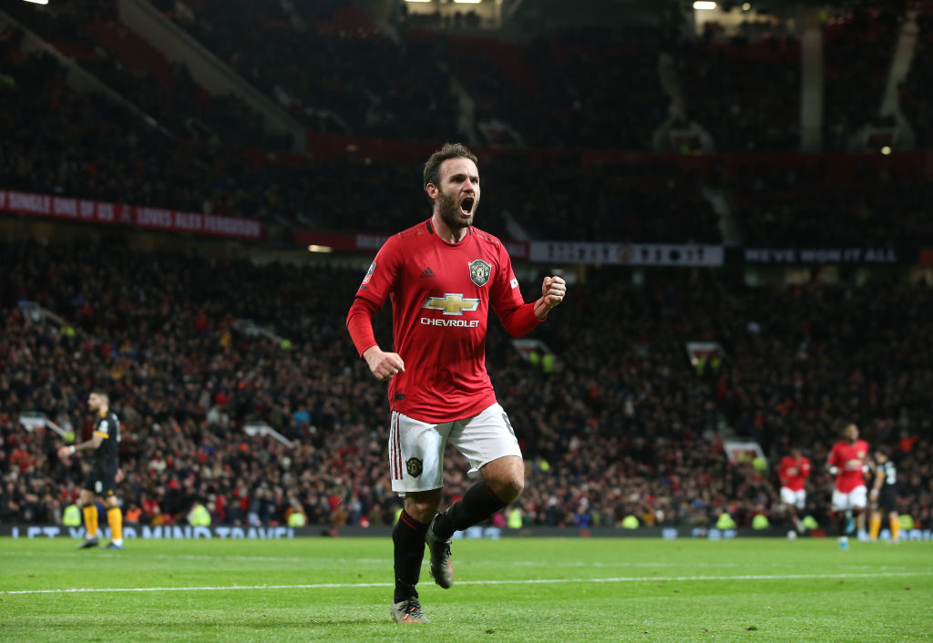 MANCHESTER, ENGLAND - JANUARY 15: Juan Mata of Manchester United celebrates scoring their first goal during the FA Cup Third Round Replay match between Manchester United and Wolverhampton Wanderers  at Old Trafford on January 15, 2020 in Manchester, England.