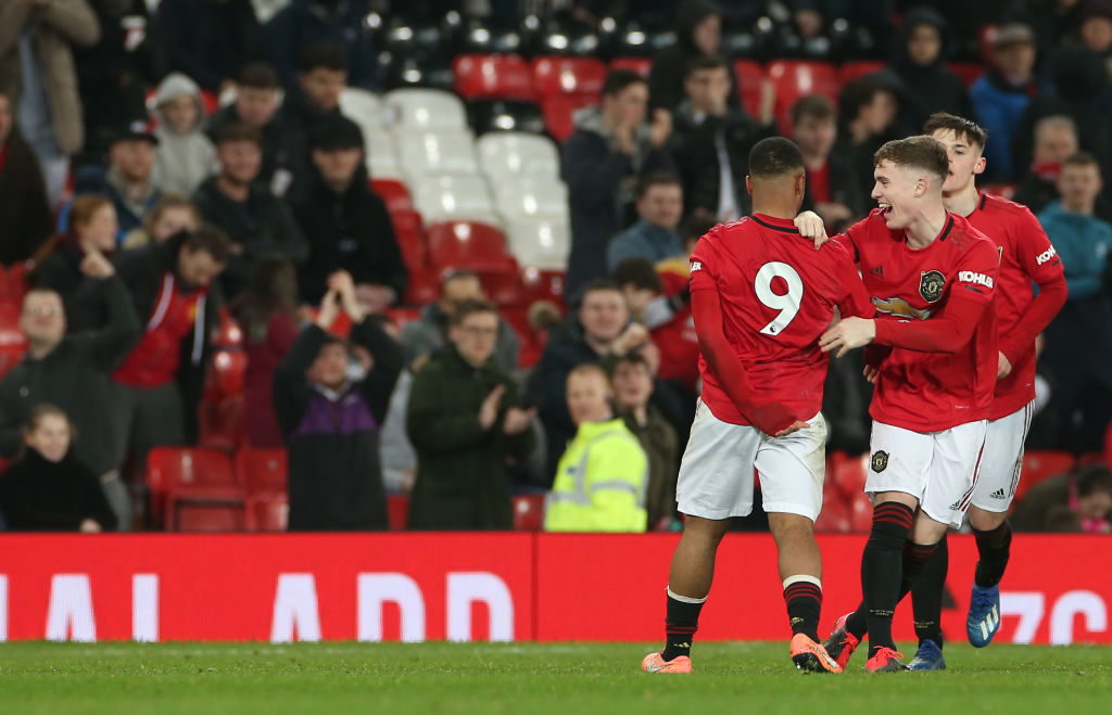 MANCHESTER, ENGLAND - FEBRUARY 05: Dillon Hoogewerf of Manchester United U18s celebrates scoring their first goal during the FA Youth Cup FIfth Round match between Manchester United U18s and Leeds United U18s at Old Trafford on February 05, 2020 in Manchester, England.