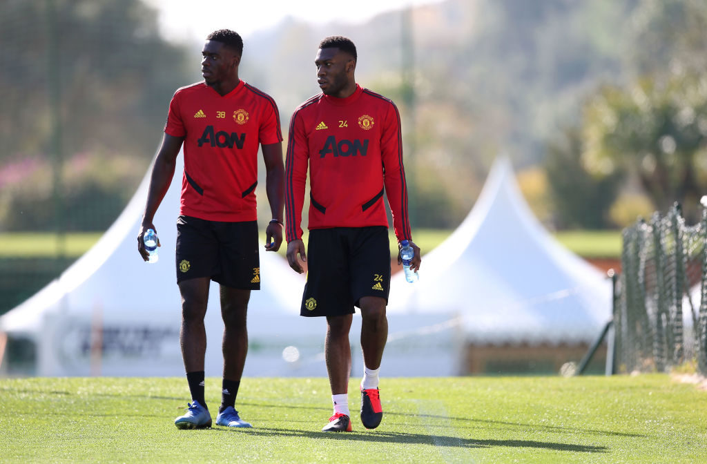 MALAGA, SPAIN - FEBRUARY 11: (EXCLUSIVE COVERAGE) Axel Tuanzebe and Timothy Fosu-Mensah of Manchester United in action during first team training session on February 11, 2020 in Malaga, Spain.