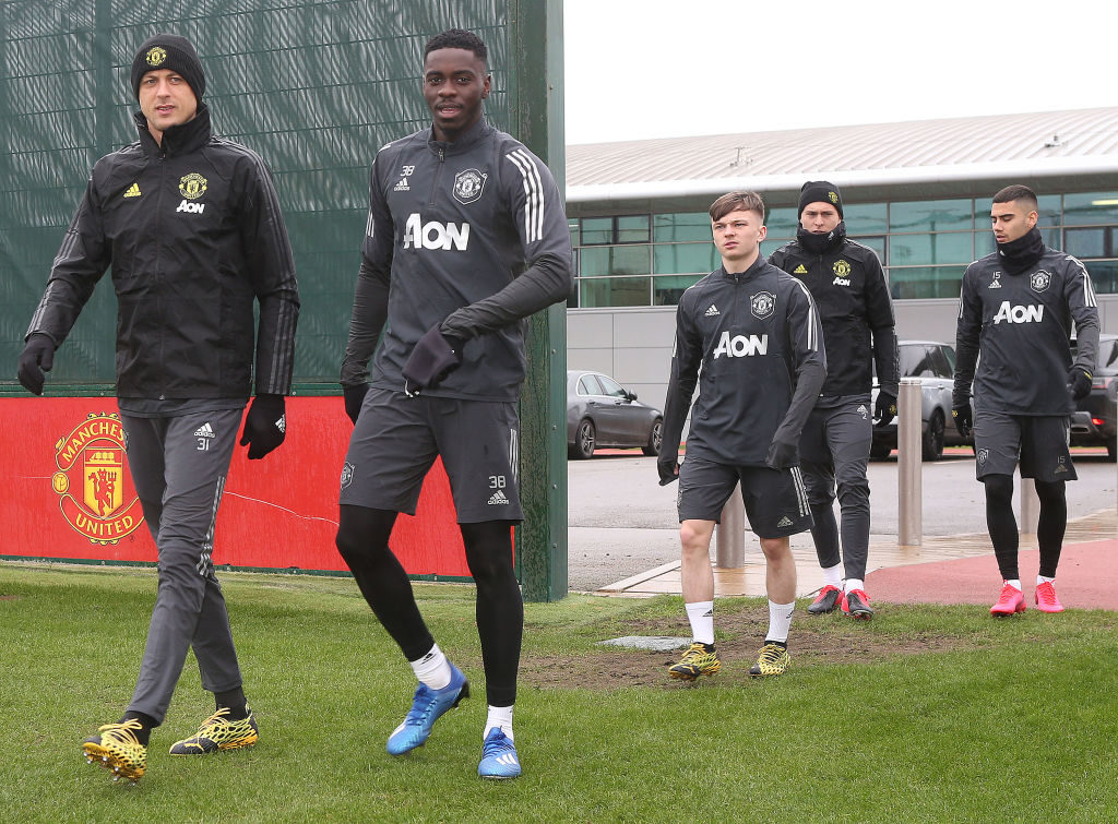 MANCHESTER, ENGLAND - FEBRUARY 19: Nemanja Matic and Axel Tuanzebe of Manchester United in action during a first team training session at Aon Training Complex on February 19, 2020 in Manchester, United Kingdom.