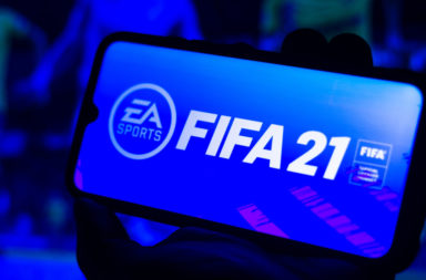 In this photo illustration the FIFA 21 logo is displayed on