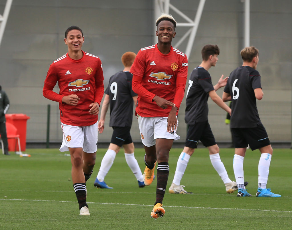 MANCHESTER, ENGLAND - SEPTEMBER 26: Noam Emeran of Manchester United U18s celebrates scoring their fifth goal during the U18 Premier League match between Manchester United U18s and Burnley U18s at Aon Training Complex on September 26, 2020 in Manchester, England.  Charlie McNeil