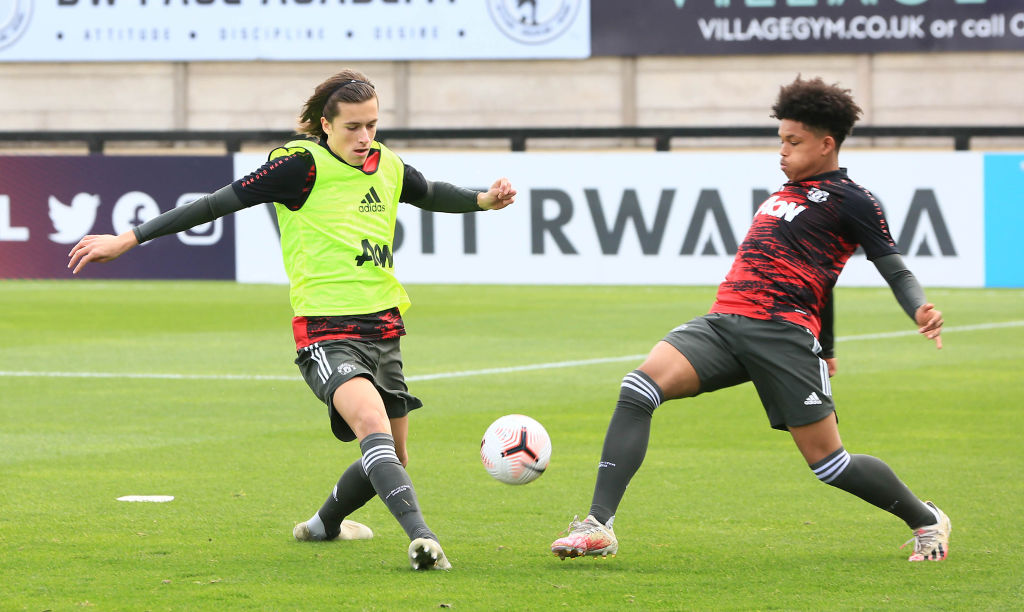 BOREHAMWOOD, ENGLAND - OCTOBER 17: Alvaro Fernandez and Shola Shoretire of Manchester United U23s warm up ahead of the Premier League 2 match between Arsenal U23s and Manchester United U23s at Meadow Park on October 17, 2020 in Borehamwood, England.