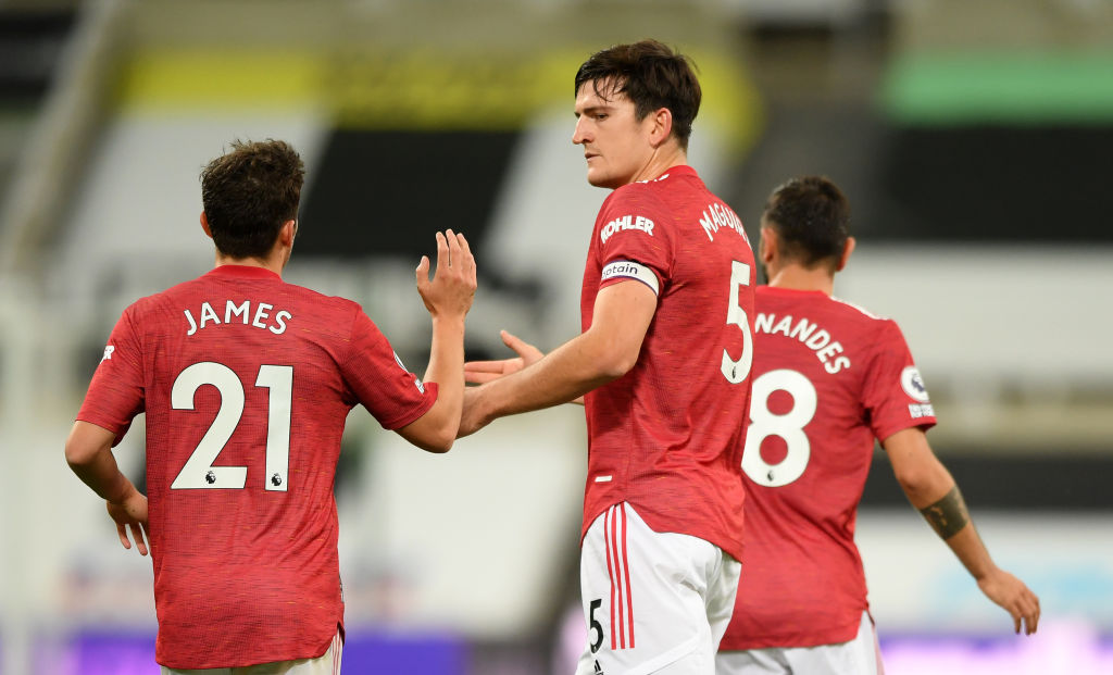 NEWCASTLE UPON TYNE, ENGLAND - OCTOBER 17: Harry Maguire of Manchester United celebrates with Daniel James of Manchester United after scoring his team's first goal during the Premier League match between Newcastle United and Manchester United at St. James Park on October 17, 2020 in Newcastle upon Tyne, England. Sporting stadiums around the UK remain under strict restrictions due to the Coronavirus Pandemic as Government social distancing laws prohibit fans inside venues resulting in games being played behind closed doors.
