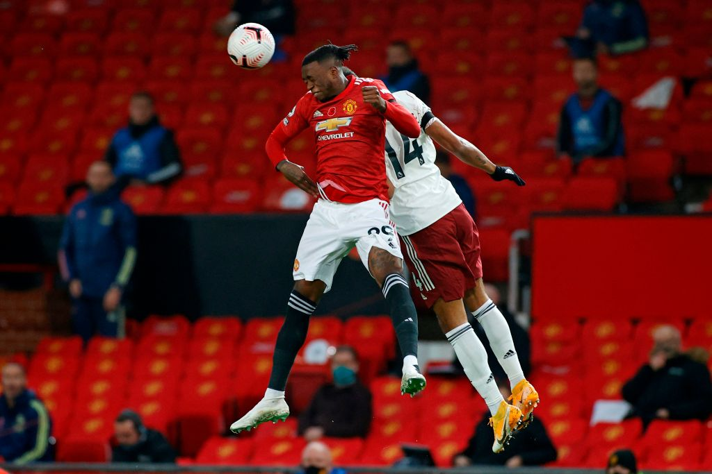Manchester United's English defender Aaron Wan-Bissaka (L) vies with Arsenal's Gabonese striker Pierre-Emerick Aubameyang (R) during the English Premier League football match between Manchester United and Arsenal at Old Trafford in Manchester, north west England, on November 1, 2020.  Most disappointing players in Manchester United vs Arsenal.