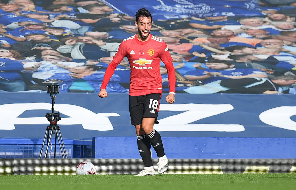 Manchester United's Portuguese midfielder Bruno Fernandes celebrates after scoring the equalising goal during the English Premier League football match between Everton and Manchester United at Goodison Park in Liverpool, north west England on November 7, 2020.