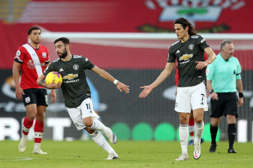 Manchester United's Portuguese midfielder Bruno Fernandes (2L) celebrates with Manchester United's Uruguayan striker Edinson Cavani after scoring during the English Premier League football match between Southampton and Manchester United at St Mary's Stadium in Southampton, southern England on November 29, 2020.