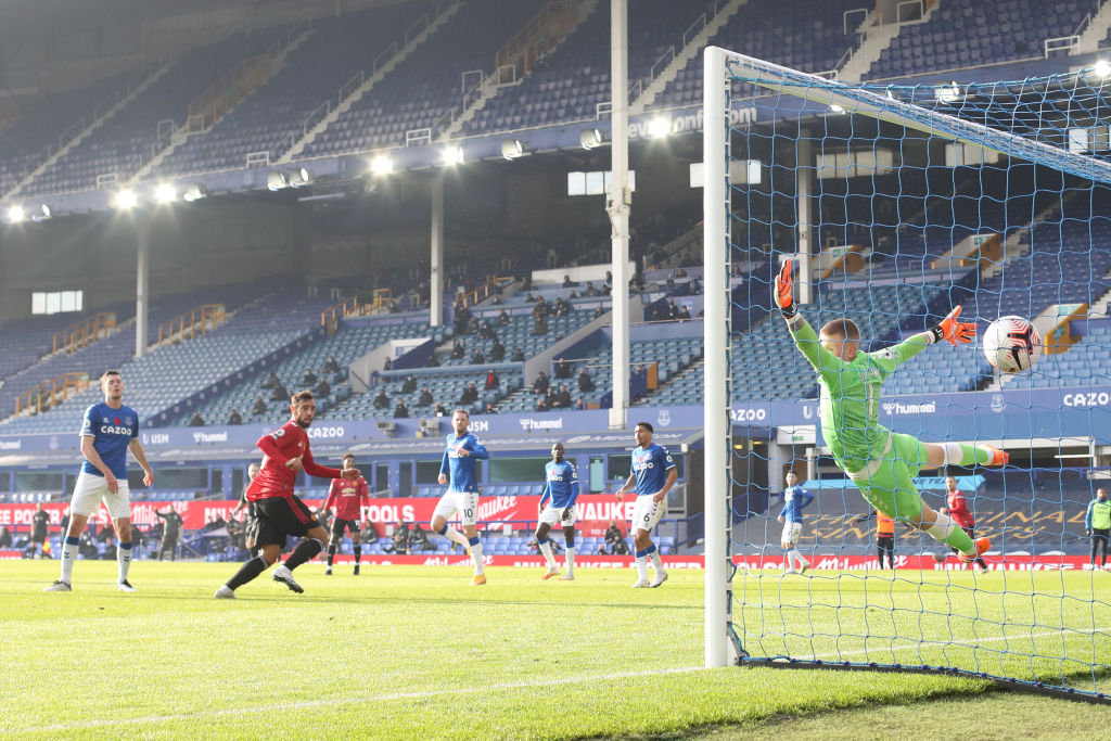 LIVERPOOL, ENGLAND - NOVEMBER 07: Bruno Fernandes of Manchester United scores his team's first goal past Jordan Pickford of Everton during the Premier League match between Everton and Manchester United at Goodison Park on November 07, 2020 in Liverpool, England. Sporting stadiums around the UK remain under strict restrictions due to the Coronavirus Pandemic as Government social distancing laws prohibit fans inside venues resulting in games being played behind closed doors.