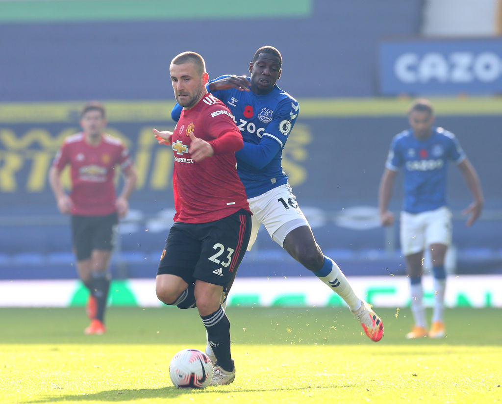 LIVERPOOL, ENGLAND - NOVEMBER 07: Luke Shaw of Manchester United in action with Abdoulaye Doucoure of Everton during the Premier League match between Everton and Manchester United at Goodison Park on November 07, 2020 in Liverpool, England. Sporting stadiums around the UK remain under strict restrictions due to the Coronavirus Pandemic as Government social distancing laws prohibit fans inside venues resulting in games being played behind closed doors.