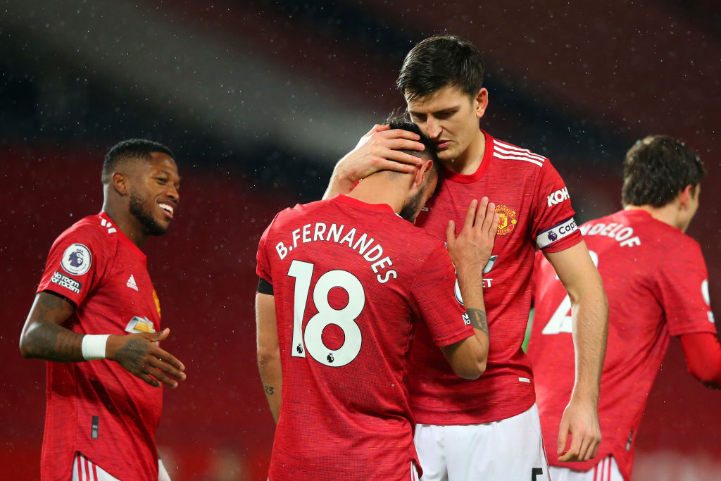 MANCHESTER, ENGLAND - NOVEMBER 21: Bruno Fernandes of Manchester United celebrates with teammate Harry Maguire after scoring his team's first goal during the Premier League match between Manchester United and West Bromwich Albion at Old Trafford on November 21, 2020 in Manchester, England. Sporting stadiums around the UK remain under strict restrictions due to the Coronavirus Pandemic as Government social distancing laws prohibit fans inside venues resulting in games being played behind closed doors.