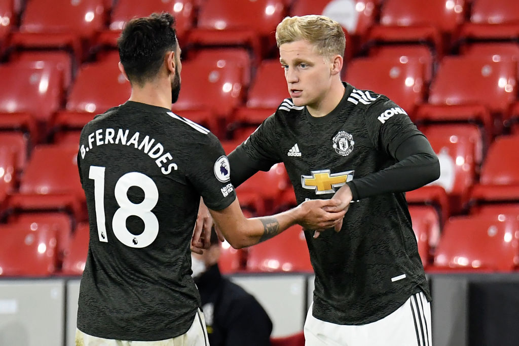 Manchester United's Dutch midfielder Donny van de Beek (R) comes on for Manchester United's Portuguese midfielder Bruno Fernandes (L) during the English Premier League football match between Sheffield United and Manchester United at Bramall Lane in Sheffield, northern England on December 17, 2020. (Photo by PETER POWELL / POOL / AFP) / RESTRICTED TO EDITORIAL USE.