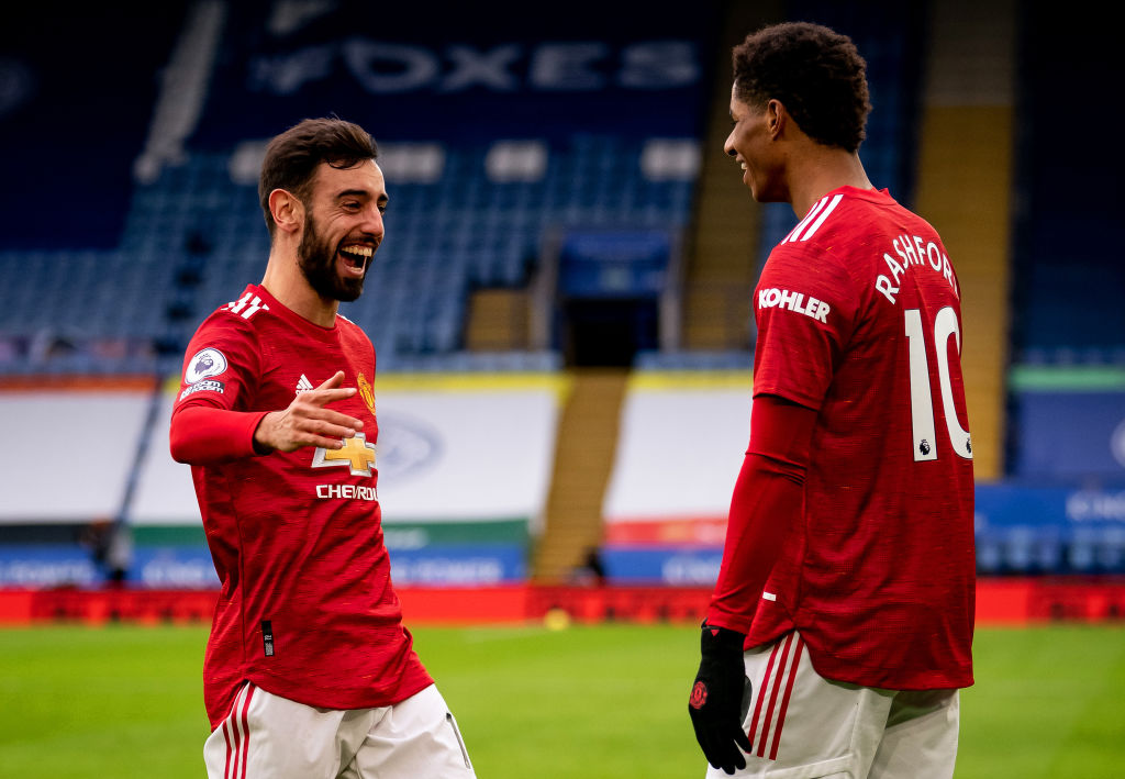 LEICESTER, ENGLAND - DECEMBER 26:  Marcus Rashford of Manchester United celebrates scoring a goal to make the score 0-1 with Bruno Fernandes during the Premier League match between Leicester City and Manchester United at The King Power Stadium on December 26, 2020 in Leicester, United Kingdom. The match will be played without fans, behind closed doors as a Covid-19 precaution. (