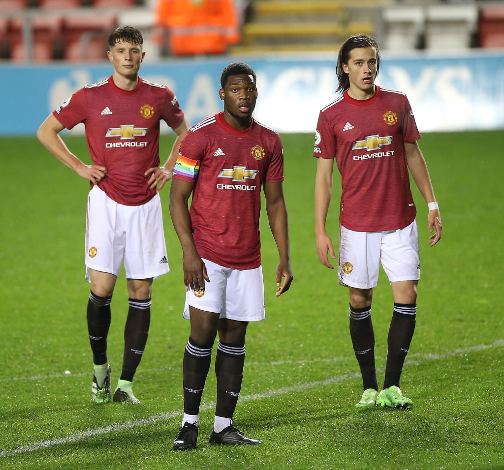 LEIGH, ENGLAND - DECEMBER 04: Will Fish, Teden Mengi, Alvaro Fernandez of Manchester United U23s in action during the Premier League 2 match between Manchester United U23s and Southampton U23s at Leigh Sports Village on December 04, 2020 in Leigh, England.