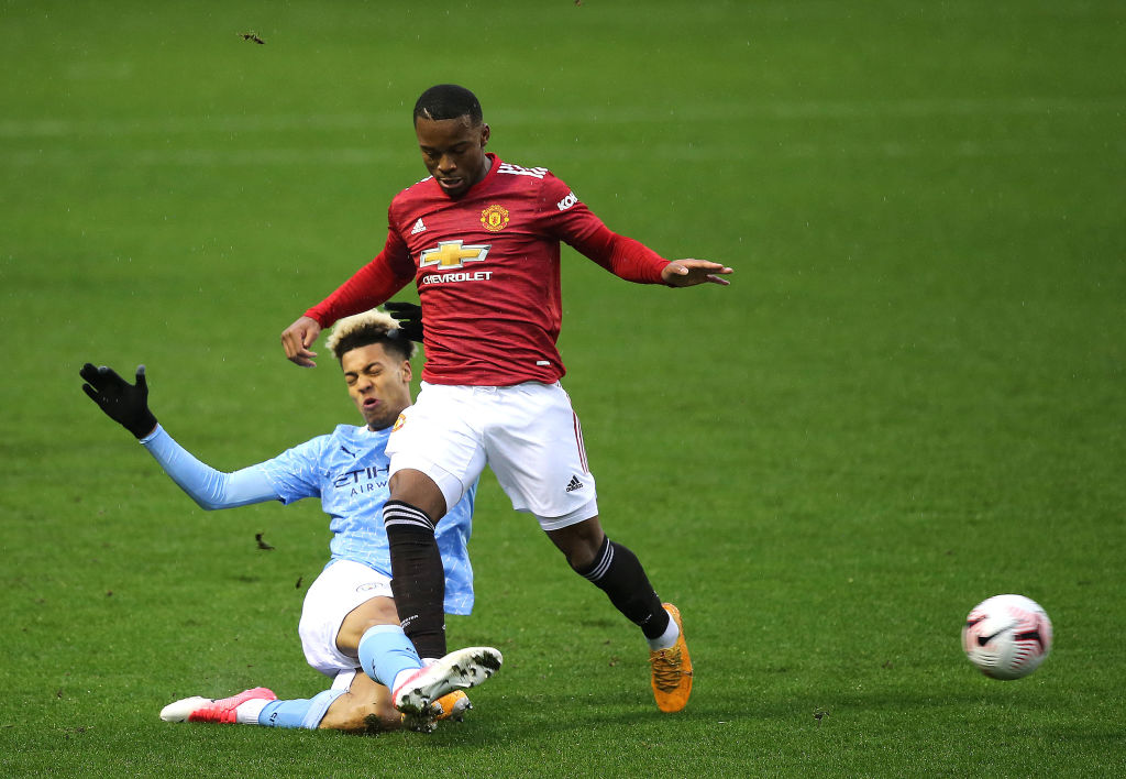 LEIGH, ENGLAND - DECEMBER 13: Ethan Laird of Manchester United U23s in action during the Premier League 2 match between Manchester United U23s and Manchester City U23s at Leigh Sports Village on December 13, 2020 in Leigh, England.