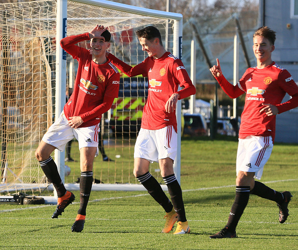 MANCHESTER, ENGLAND - DECEMBER 17: Charlie McNeill of Manchester United U18s celebrates scoring their first goal during the U18 Premier League match between Manchester United U18s and Leeds United U18s at Aon Training Complex on December 17, 2020 in Manchester, England.