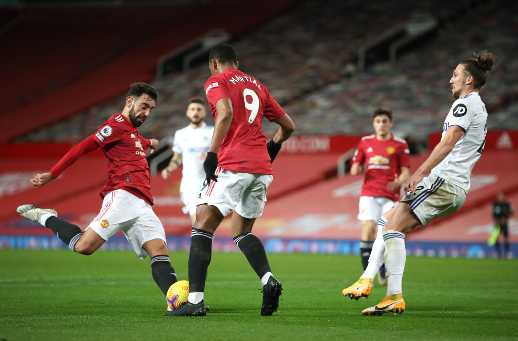 MANCHESTER, ENGLAND - DECEMBER 20: Bruno Fernandes of Manchester United scores their team's third goal  during the Premier League match between Manchester United and Leeds United at Old Trafford on December 20, 2020 in Manchester, England. The match will be played without fans, behind closed doors as a Covid-19 precaution.