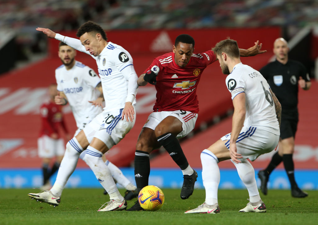 MANCHESTER, ENGLAND - DECEMBER 20: Anthony Martial of Manchester United in action with Rodrigo and Liam Cooper of Leeds United during the Premier League match between Manchester United and Leeds United at Old Trafford on December 20, 2020 in Manchester, England.