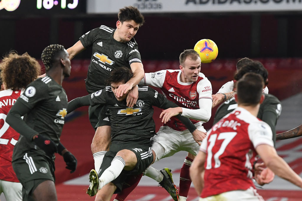 Arsenal's English defender Rob Holding (centre right) jumps for the ball with Manchester United's Swedish defender Victor Lindelof (C) and Manchester United's English defender Harry Maguire (center left) during the English Premier League football match between Arsenal and Manchester United at the Emirates Stadium in London on January 30, 2021. (Photo by Andy Rain / POOL / AFP)