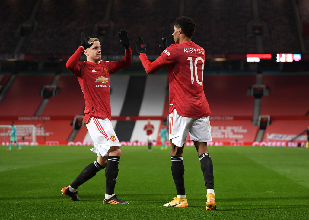 MANCHESTER, ENGLAND - JANUARY 24: Marcus Rashford of Manchester United celebrates after scoring their sides second goal with team mate Donny van de Beek during The Emirates FA Cup Fourth Round match between Manchester United and Liverpool at Old Trafford on January 24, 2021 in Manchester, England. Sporting stadiums around the UK remain under strict restrictions due to the Coronavirus Pandemic as Government social distancing laws prohibit fans inside venues resulting in games being played behind closed doors.