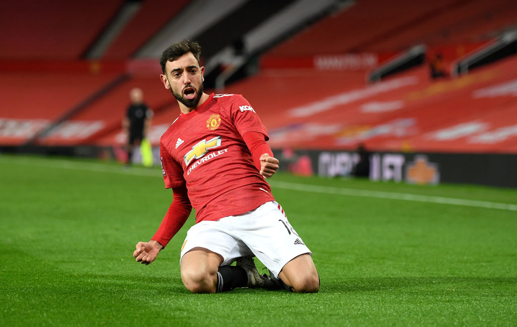 MANCHESTER, ENGLAND - JANUARY 24: Bruno Fernandes of Manchester United celebrates after scoring their sides third goal from a free kick during The Emirates FA Cup Fourth Round match between Manchester United and Liverpool at Old Trafford on January 24, 2021 in Manchester, England. Sporting stadiums around the UK remain under strict restrictions due to the Coronavirus Pandemic as Government social distancing laws prohibit fans inside venues resulting in games being played behind closed doors.