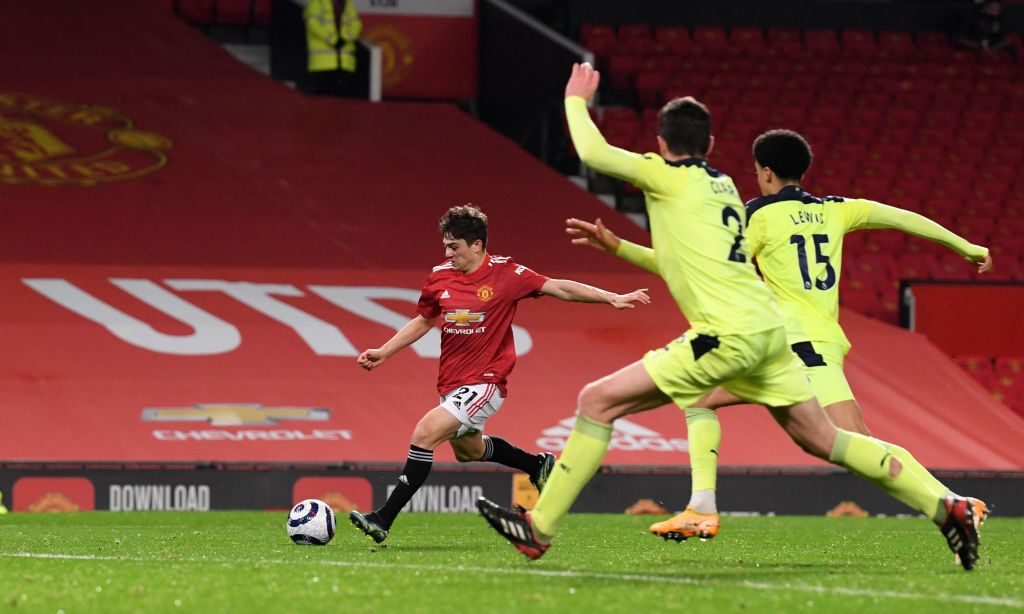 Manchester United's Welsh midfielder Daniel James (C) prepares to shoot at goal to score his team's second goal during the English Premier League football match between Manchester United and Newcastle at Old Trafford in Manchester, north west England, on February 21, 2021. (Photo by Stu Forster / POOL / AFP)