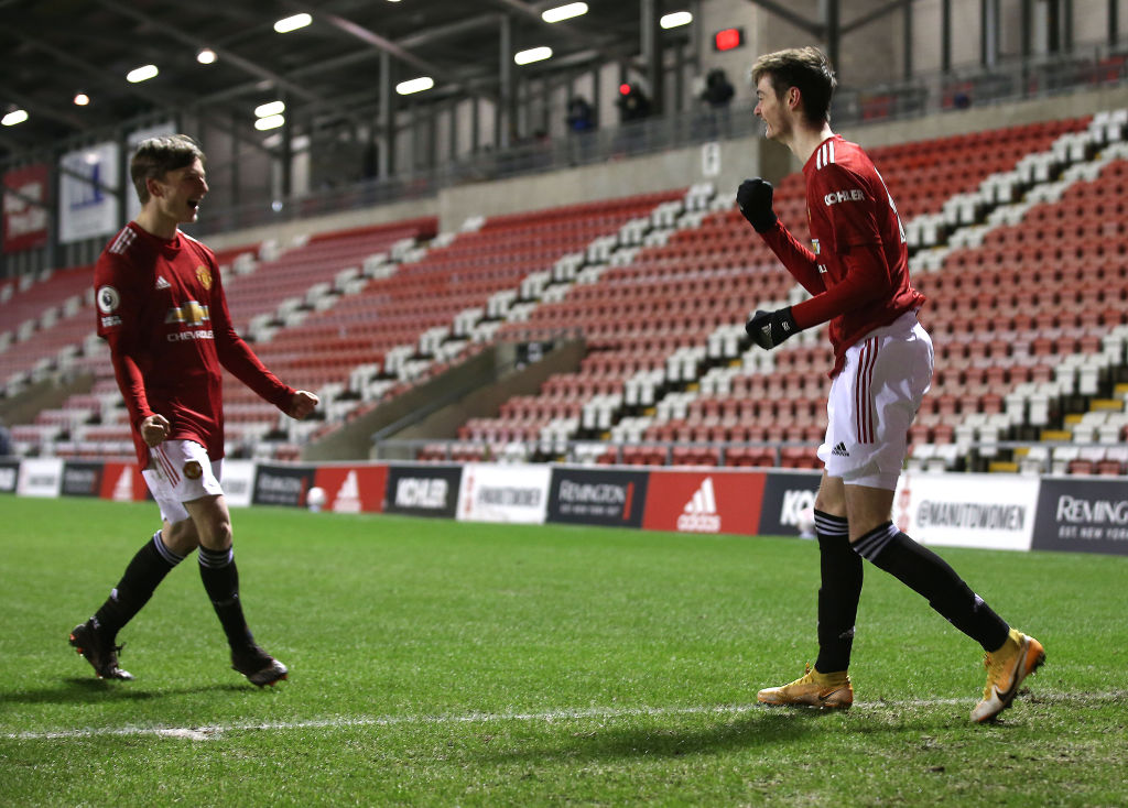 LEIGH, ENGLAND - FEBRUARY 12: Joe Hugill of Manchester United U23s celebrates scoring their second goal during the Premier League 2 match between Manchester United U23s and Arsenal U23s at Leigh Sports Village on February 12, 2021 in Leigh, England.
