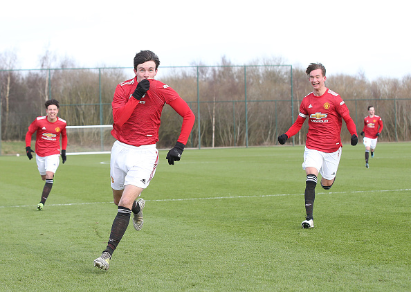 MANCHESTER, ENGLAND - FEBRUARY 13: Charlie McNeill of Manchester United U18s celebrates scoring their first goal during the U18 Premier League match between Manchester United U18s and Manchester City U18s at Aon Training Complex on February 13, 2021 in Manchester, England.