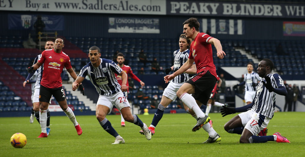 WEST BROMWICH, ENGLAND - FEBRUARY 14: Harry Maguire of Manchester United in action with Mbaye Diagne of West Bromwich Albion during the Premier League match between West Bromwich Albion and Manchester United at The Hawthorns on February 14, 2021 in West Bromwich, England.