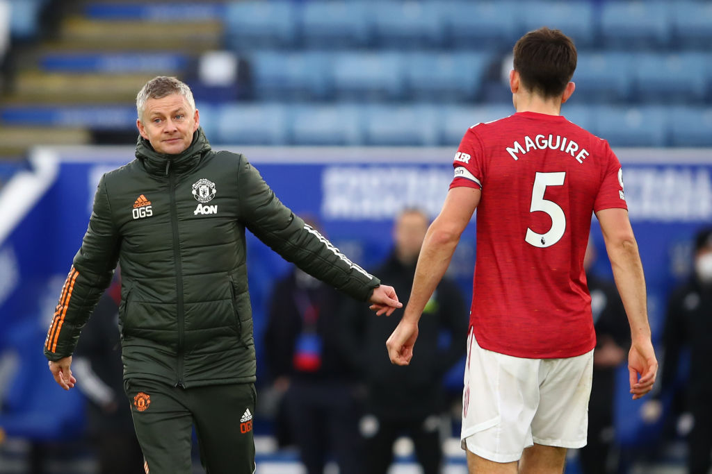 LEICESTER, ENGLAND - DECEMBER 26: Ole Gunnar Solskjaer manager of Manchester United with Harry Maguire after the Premier League match between Leicester City and Manchester United at The King Power Stadium on December 26, 2020 in Leicester, United Kingdom. The match will be played without fans, behind closed doors as a Covid-19 precaution.