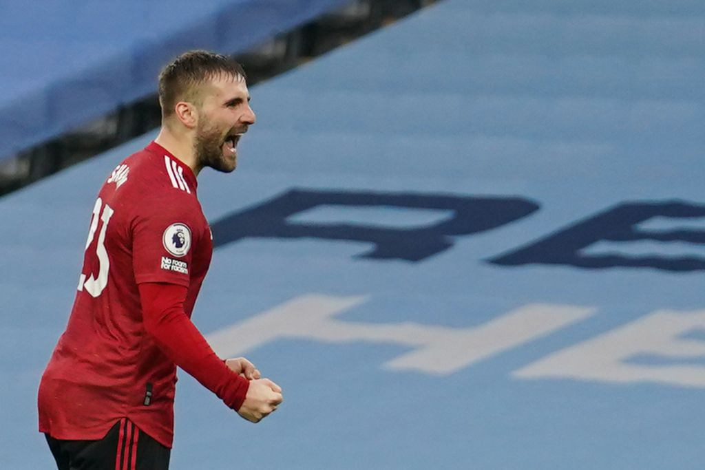 Manchester United's English defender Luke Shaw celebrates scoring their second goal during the English Premier League football match between Manchester City and Manchester United at the Etihad Stadium in Manchester, north west England, on March 7, 2021. (Photo by Dave Thompson / POOL / AFP)