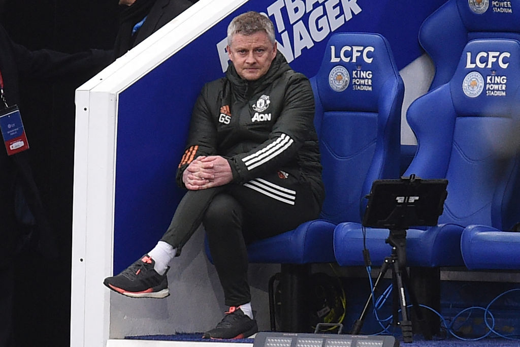 Manchester United's Norwegian manager Ole Gunnar Solskjaer watches from his seat during the English FA Cup quarter-final football match between Leicester City and Manchester United at King Power Stadium in Leicester, central England on March 21, 2021. - RESTRICTED TO EDITORIAL USE.