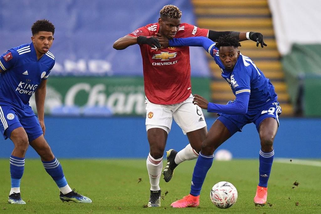 Leicester City's Nigerian midfielder Wilfred Ndidi (R) vies with Manchester United's French midfielder Paul Pogba (C) during the English FA Cup quarter-final football match between Leicester City and Manchester United at King Power Stadium in Leicester, central England on March 21, 2021.