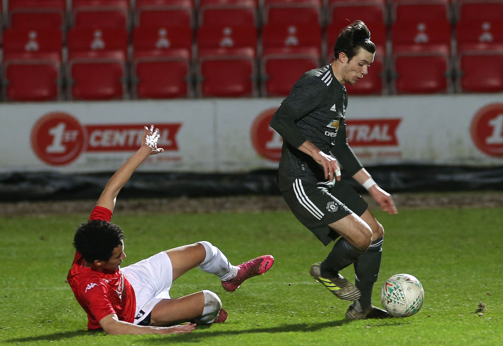SALFORD, ENGLAND - MARCH 10: Charlie McNeill of Manchester United U18s in action during the FA Youth Cup match between Salford City U18s and Manchester United U18s at Peninsula Stadium on March 10, 2021 in Salford, England.