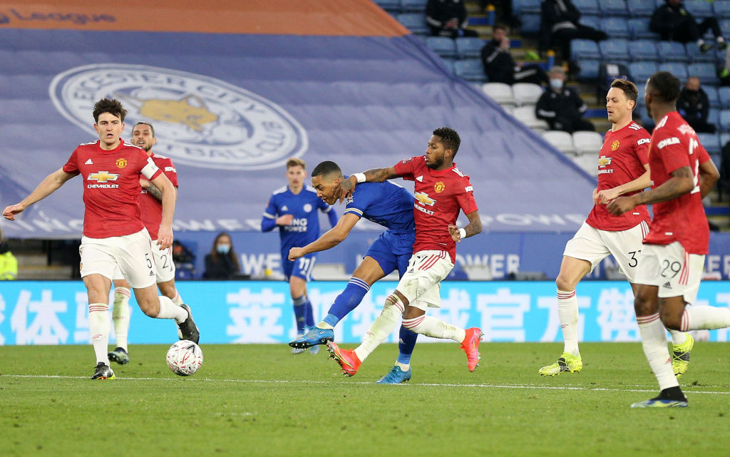 LEICESTER, ENGLAND - MARCH 21: Youri Tielemans of Leicester City scores their side's second goal whilst under pressure from Fred of Manchester United during the Emirates FA Cup Quarter Final match between Leicester City and Manchester United at The King Power Stadium on March 21, 2021 in Leicester, England. Sporting stadiums around the UK remain under strict restrictions due to the Coronavirus Pandemic as Government social distancing laws prohibit fans inside venues resulting in games being played behind closed doors.