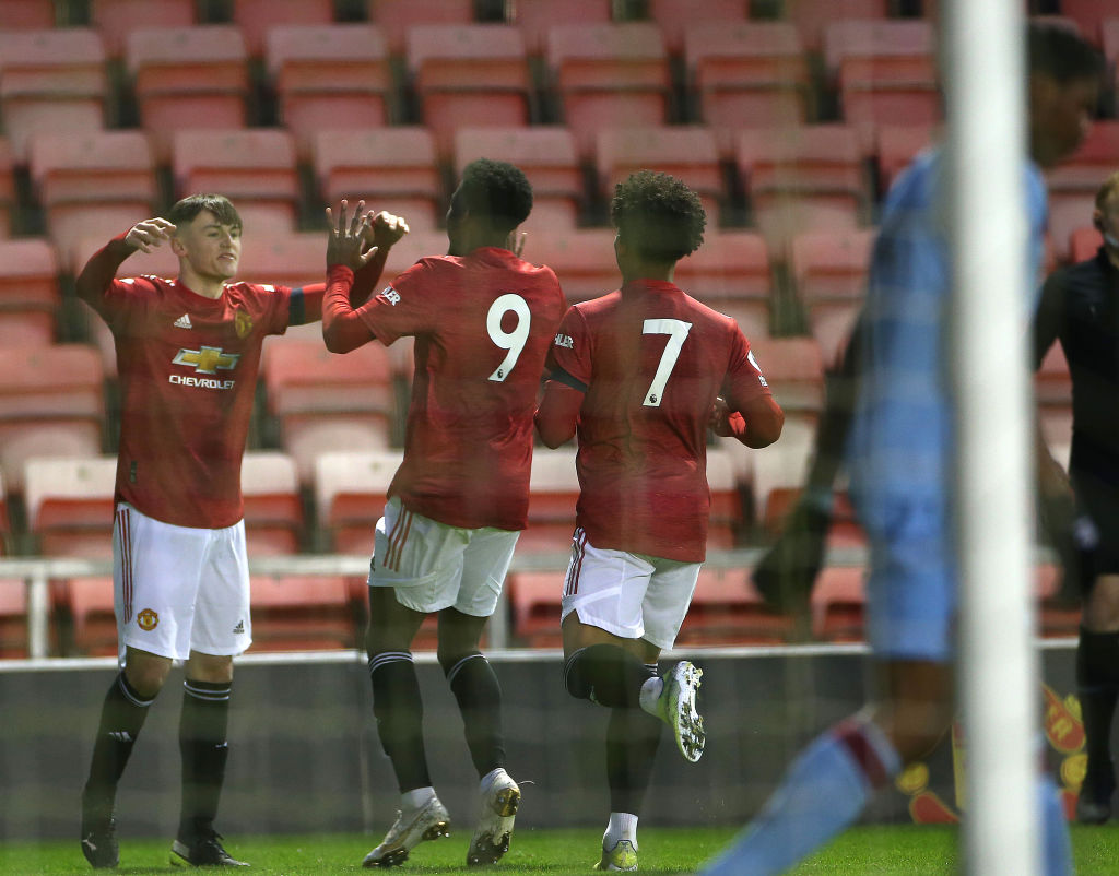 LEIGH, ENGLAND - APRIL 09: Mark Helm of Manchester United U23s celebrates scoring their first goal during the Premier League 2 match between Manchester United U23s and West Ham United U23s at Leigh Sports Village on April 09, 2021 in Leigh, England.