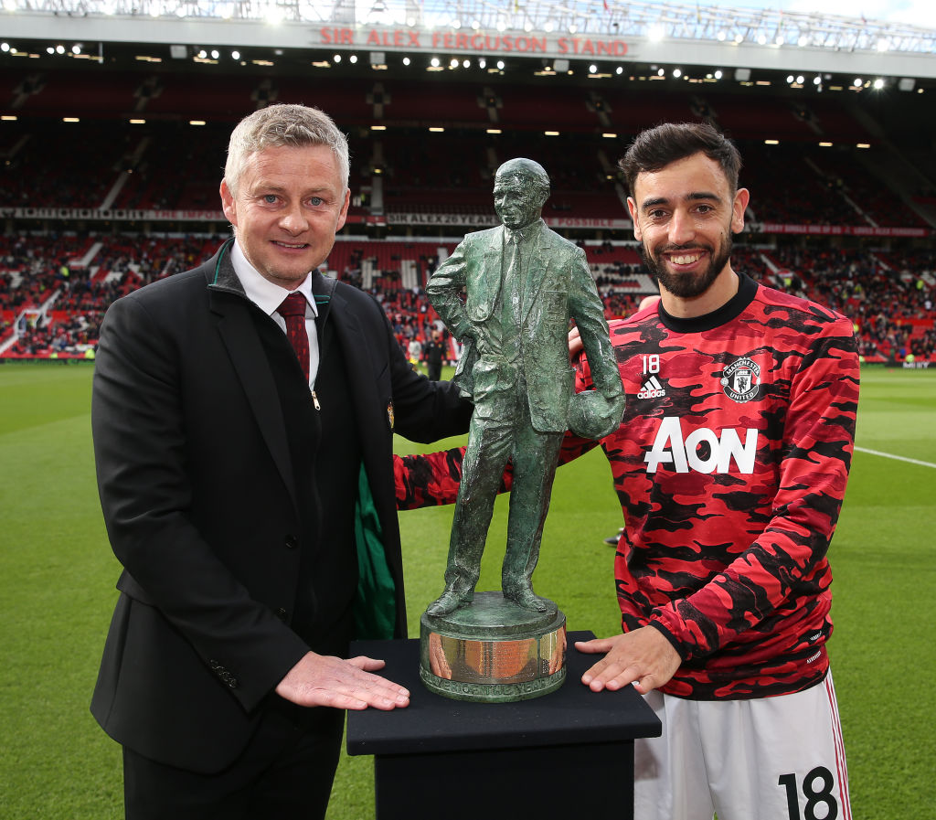 Bruno Fernandes of Manchester United poses with the Sir Matt Busby Player of the Year award