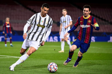 Cristiano Ronaldo (L) of Juventus FC is challenged by Lionel
