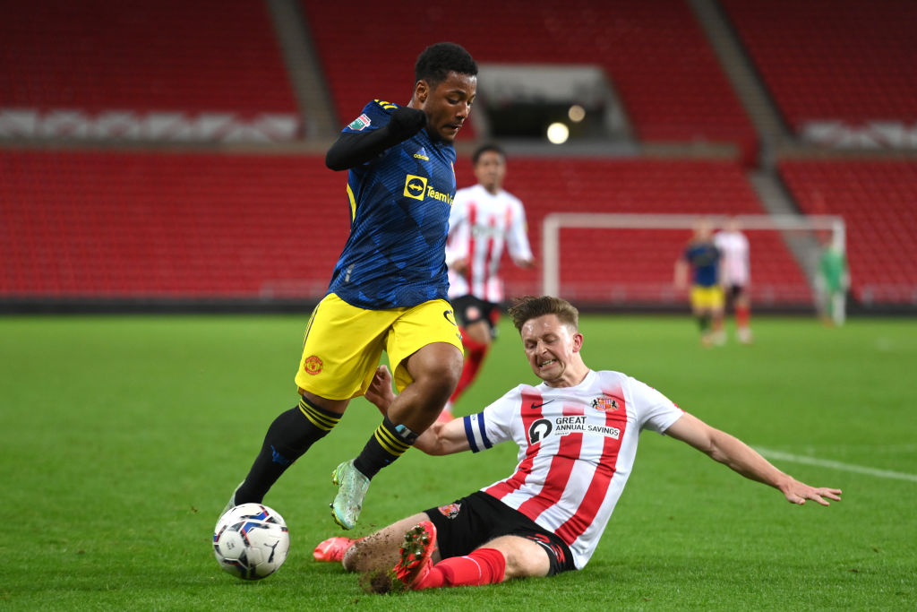Dillon Hoogewerf is challenged by Sunderland captain Denver Hume